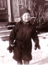 Kit in the snow, age 2